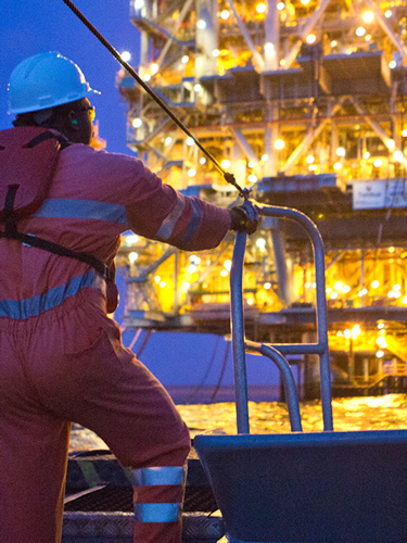 Chevron worker looking at offshore platform